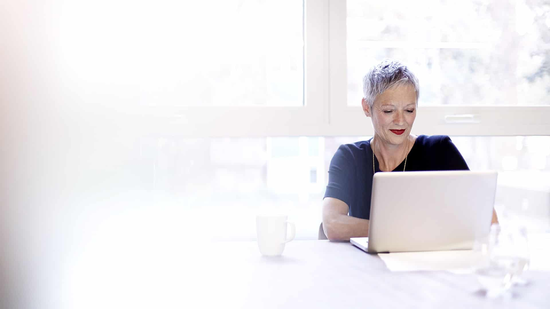 Mature business woman working on a laptop
